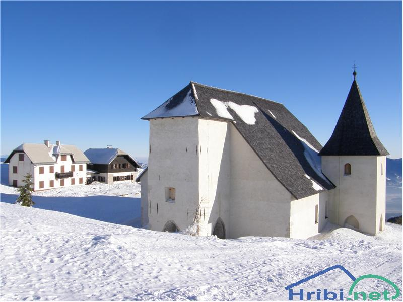 A winter shot of the cottage and church, borrowed from www.hribi.net